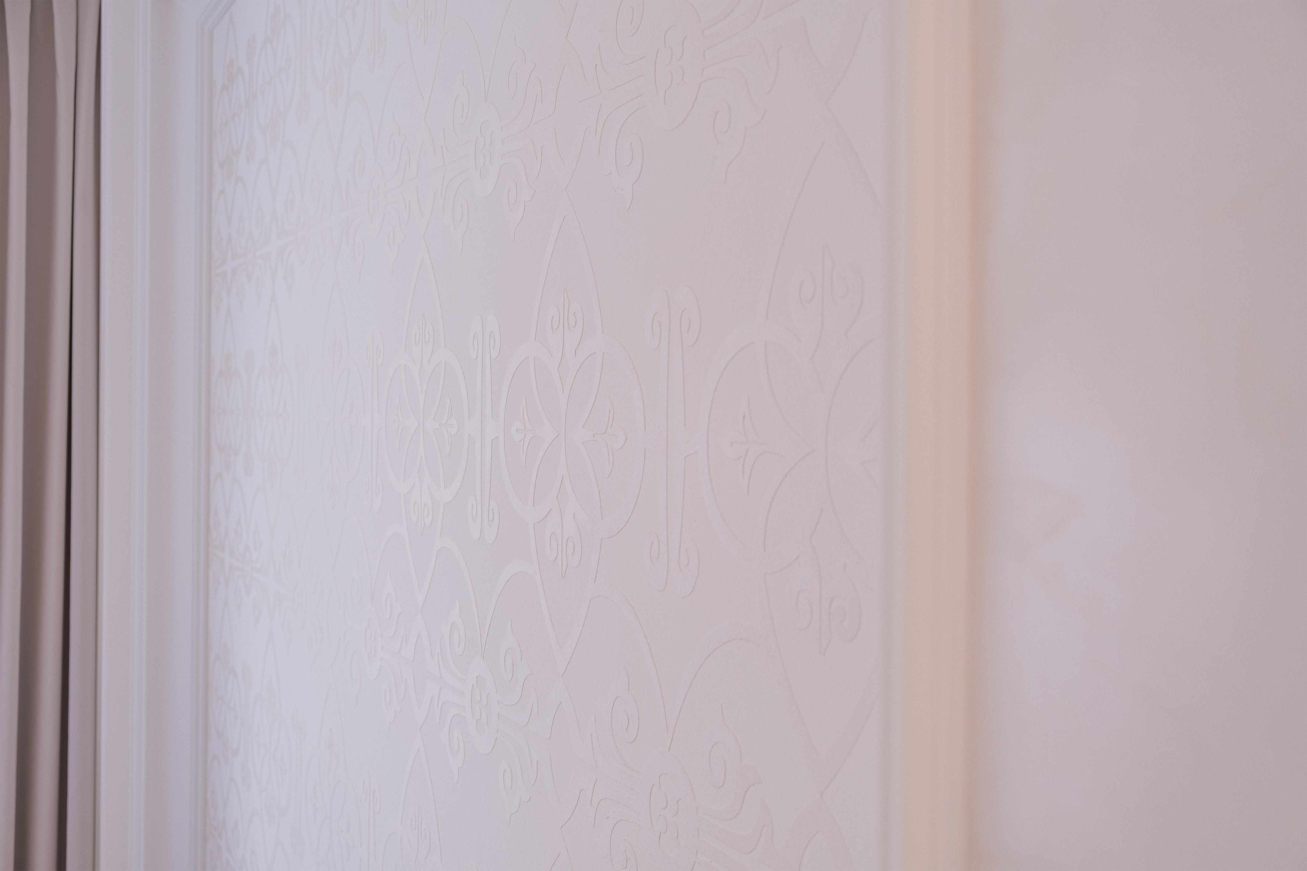 Декоративная штукатурка стены дома в Совиньоне Одесса